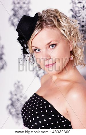 Glamoured retro styled portrait with blond model, head and shoulders