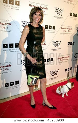 LOS ANGELES - MAR 23:  Wendie Malick arrives at the 2013 Genesis Awards Benefit Gala at the Beverly Hilton Hotel on March 23, 2013 in Beverly Hills, CA