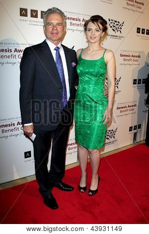 LOS ANGELES - MAR 23:  Tony Denison, Melissa Biton arrives at the 2013 Genesis Awards Benefit Gala at the Beverly Hilton Hotel on March 23, 2013 in Beverly Hills, CA