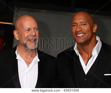 LOS ANGELES - MAR 28:  Bruce Willis, Dwayne Johnson arrives at the