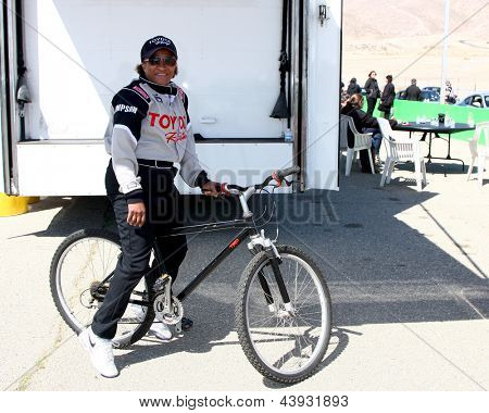 LOS ANGELES - MAR 23:  Wanda Sykes using the community bike at the 37th Annual Toyota Pro/Celebrity Race training at the Willow Springs International Speedway on March 23, 2013 in Rosamond, CA