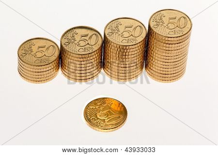 some stacks of euro coins on a white background