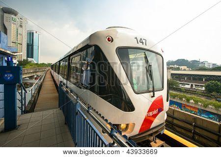 KUALA LUMPUR, MALAYSIA - MAR 30: Monorail train on Mar 30, 2013 in Kuala Lumpur, Malaysia. KL Monorail opened on 31 August 2003, and serves 11 stations running 8.6 km.