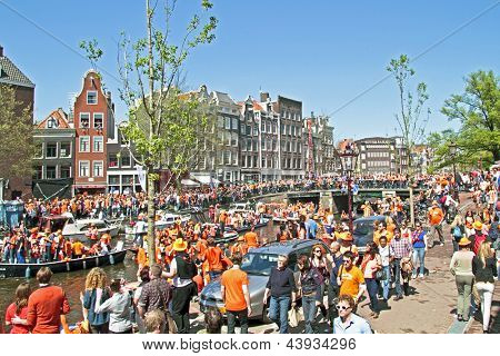 AMSTERDAM - APRIL 30: Big crowds in orange from people partying at the celebration of queensday on April 30, 2012 in Amsterdam, The Netherlands