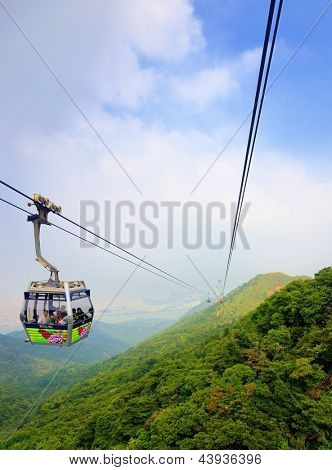 HONG KONG - OCTOBER 15: Ngong Ping Cable Car October 15, 2012 in Hong Kong, PRC. The 5.7 km gondola which connects Tung Chung and Gnong Ping on Lantau Island is operated by Mass Transit Railway (MTR).
