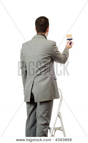 Businessman Painting A Sign