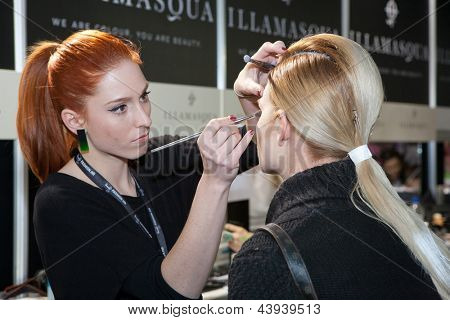 ZAGREB, CROATIA - MARCH 15: Fashion model prepares in backstage for Couture show by Marina Design on 'Fashion.hr' show, on March 15, 2013 in Zagreb, Croatia.