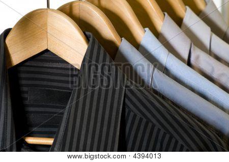 Dress Shirts On Hangers.