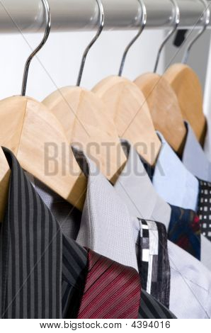 Dress Shirts And Ties On Hangers.