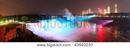 Niagara Falls lit at night panorama by colorful lights