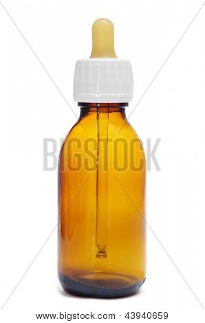 empty amber glass bottle with dropper on a white background
