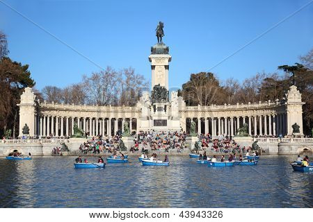MADRID - MARCH 11: Tourists boat near monument to Alfonso XII at pond in Retiro Park on March 11 2012 in Madrid, Spain. Spain in March 2012, received about 3,6 million foreign tourists.