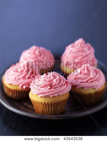 Group of pink cupcakes selective focus