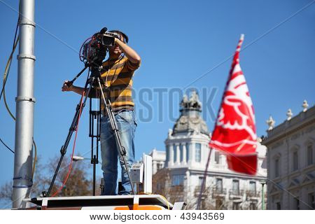 MADRID - MARCH 11: Videooperator shoots Demonstration of Communist Party on March 11, 2012 in Madrid, Spain. Spaniards came out on March 11 on streets 60 cities to protest against labor law reform.
