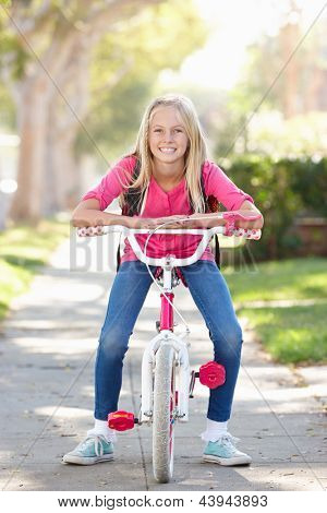 Girl Wearing Rucksack Cycling To School
