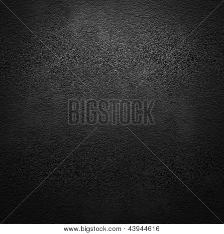 Black scratched grunge wall background or texture