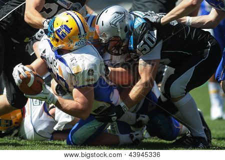 INNSBRUCK, AUSTRIA - APRIL 28: LB Alex Gross (#37 Giants) is tackled by LB Mario Rinner (#50 Raiders) on April 28, 2012 in Innsbruck, Austria.