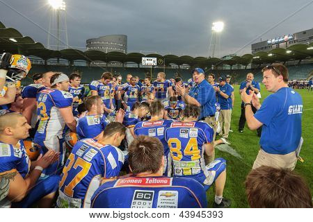VIENNA, AUSTRIA - JUNE 2: Head Coach Nick Johansen talks to his team in the huddle on JUNE 2, 2012 in Graz, Austria.