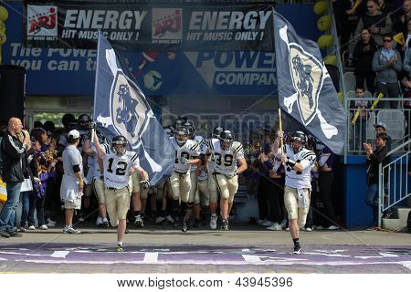 VIENNA, AUSTRIA - MAY 13: QB Justin Walz (#12 Panthers) leads his team on the football field on May 13, 2012 in Vienna, Austria.