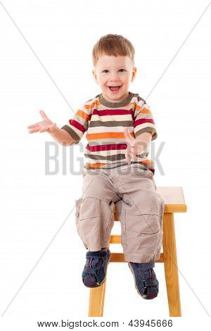 Little boy sitting on stool