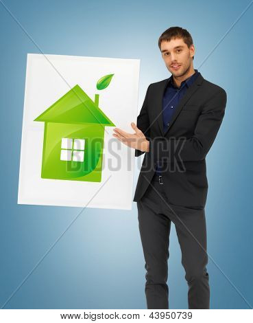 handsome man with illustration of green eco house