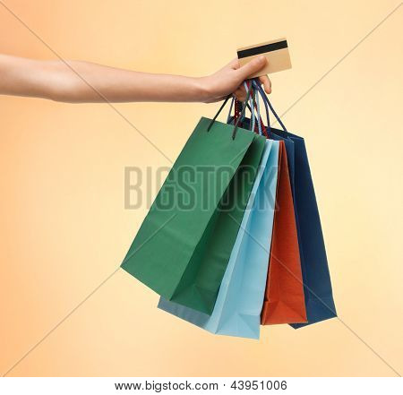 closeup of multi colored shopping bags and credit card.