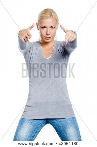 Woman in gray sweater gesturing guns with her hands, isolated on white