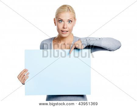 Woman keeps and points with hand at the copyspace, isolated on white