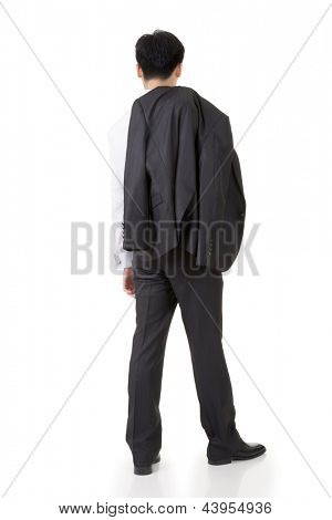 Asian businessman put coat on his shoulder, rear view full length portrait isolated on white background.
