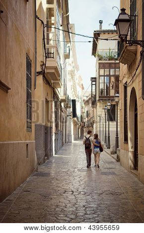 Loving Couple Walking Down The Street