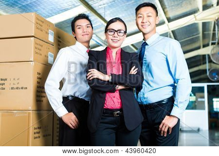 Manager, owner or businesspeople in a warehouse of a forwarding agency or a factory