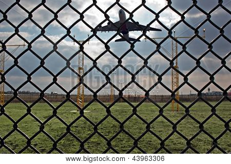 Looking Through Airport Security Fence