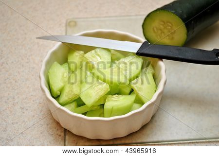 Cucumber Slices With a Knife