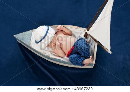 Newborn Baby Boy Sailor Sleeping in a Boat