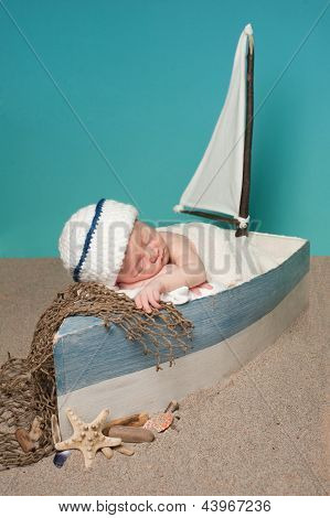Newborn Baby Boy Sailor Sleeping in a Sailboat