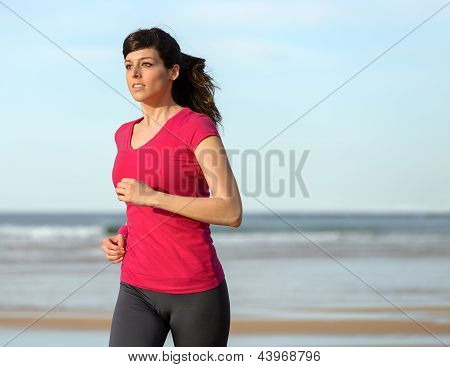 Woman Working Out On Beach
