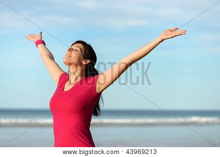 Happy Fitness Woman Raising Arms