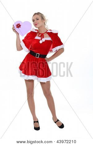 Saucy Miss Santa with a heart shaped giftbox