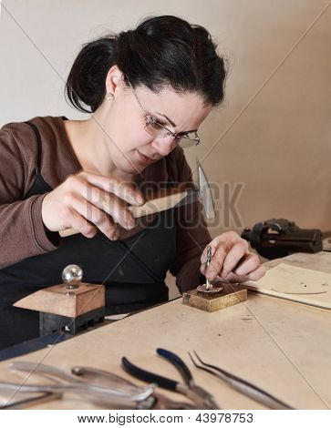 Female Jeweler Working