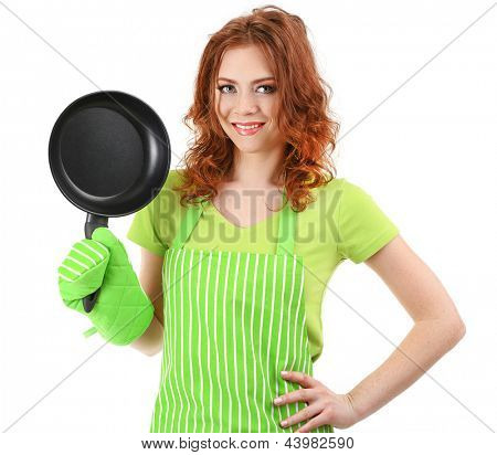 Young woman wearing kitchen apron with pan, isolated on white