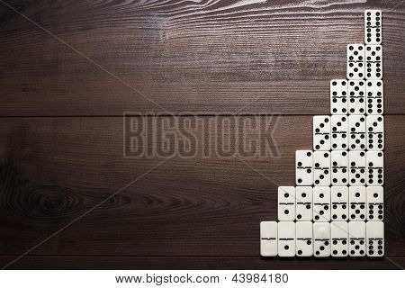 full set of domino pieces on wooden table