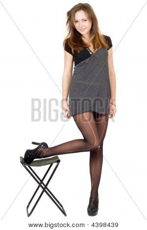 Young Woman In The Torn Stockings And A Chair