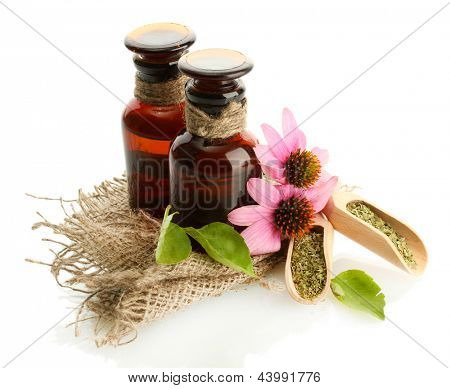 medicine bottles with purple echinacea , isolated on white