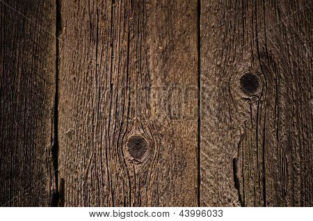 Background for design. The texture of old wood with cracks and knots
