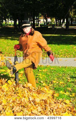 Woman Near Pile Leaves