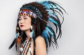 stock photo of indian chief  - Young woman in costume of American Indian - JPG