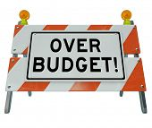 picture of budget  - A road construction barrier with the words Over Budget to symbolize financial danger and overspending - JPG