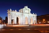 stock photo of neo-classic  - Arch Puerta de Alcala at Independence of Spain square at night in Madrid - JPG