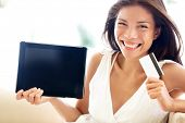 stock photo of multicultural  - Internet shopping woman online with tablet pc and credit card - JPG