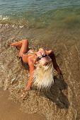 foto of bimbo  - Beautiful young blonde fit woman in bikini on the beach - JPG